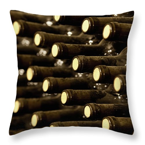 Stellenbosch Throw Pillow featuring the photograph Bottled Red Wine Aging In Wine Cellar by Siegfried Layda