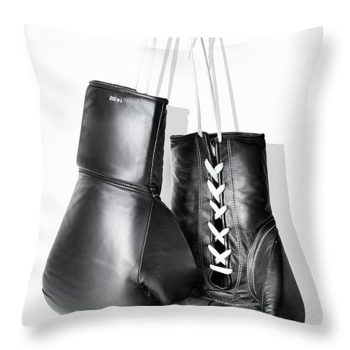 Hanging Throw Pillow featuring the photograph Boxing Gloves Hanging Against White by Burazin
