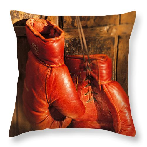Hanging Throw Pillow featuring the photograph Boxing Gloves Hanging On Rustic Wooden by Comstock