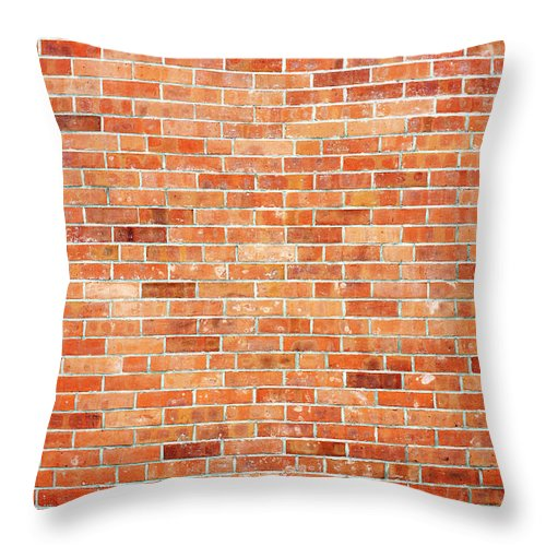 Toughness Throw Pillow featuring the photograph Brick Wall by Ballyscanlon
