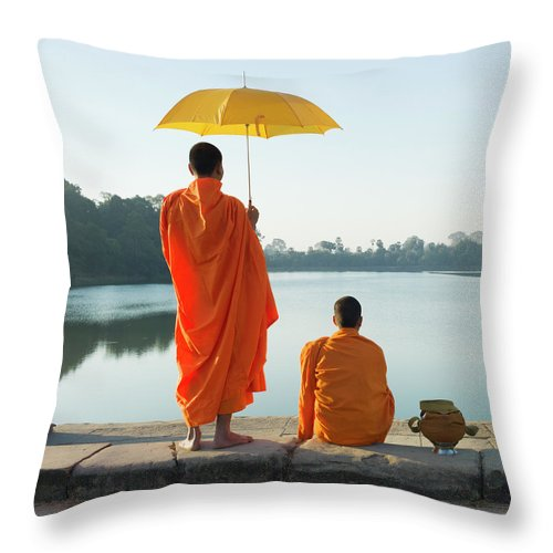 Young Men Throw Pillow featuring the photograph Buddhist Monks Standing In Front Of by Martin Puddy