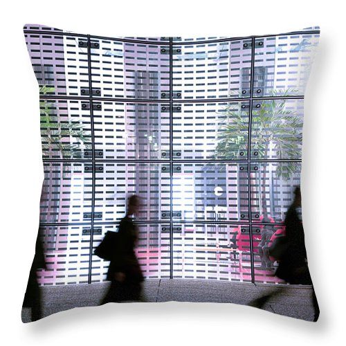 People Throw Pillow featuring the photograph Business People Passing Modern Office by Eschcollection