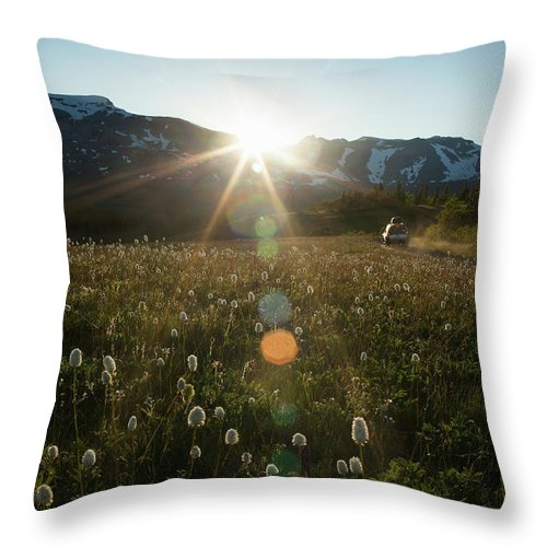 Scenics Throw Pillow featuring the photograph Car On Rural Dirt Road In Mountains At by Noah Clayton