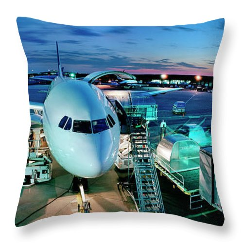 Freight Transportation Throw Pillow featuring the photograph Cargo Plane Being Loaded At Night by Greg Pease