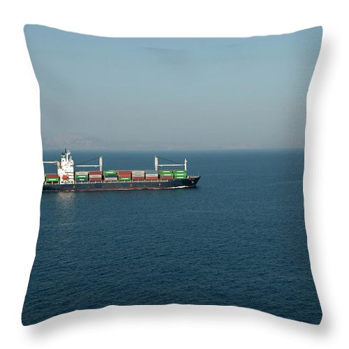 Freight Transportation Throw Pillow featuring the photograph Cargo Ship At Sea by Mitch Diamond
