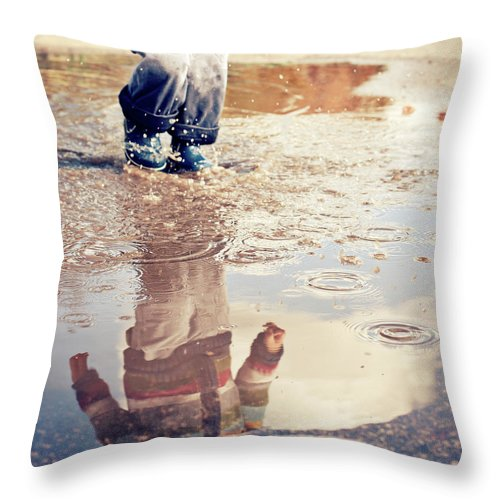 Toddler Throw Pillow featuring the photograph Child In A Puddle by Vpopovic