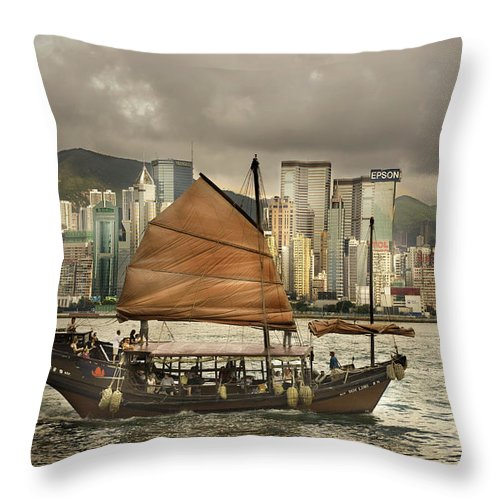 Sailboat Throw Pillow featuring the photograph China, Hong Kong, Junk Boat In Bay by Maremagnum