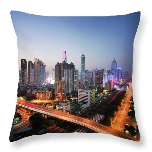 Corporate Business Throw Pillow featuring the photograph China, Shenzen Skyline At Dusk by Martin Puddy