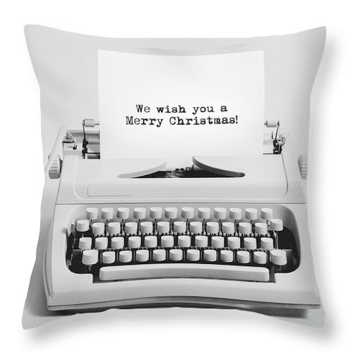Christmas Throw Pillow featuring the photograph Christmas Wishes Written On An Old Typewriter. by Michal Bednarek