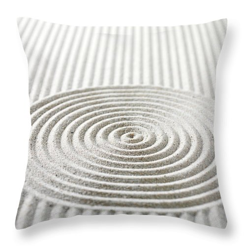 In A Row Throw Pillow featuring the photograph Circles And Lines In Sand by Wragg