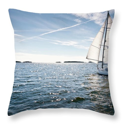 Recreational Pursuit Throw Pillow featuring the photograph Classic Yacht Sailing Away Against Blue by Jaap-willem