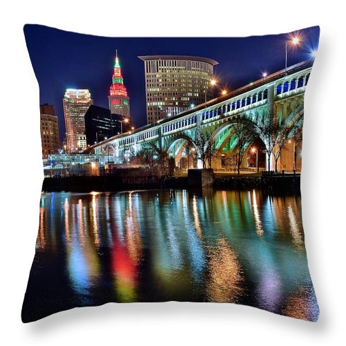Cleveland Throw Pillow featuring the photograph Cleveland Ohio Skyline Reflects Colorfully by Frozen in Time Fine Art Photography