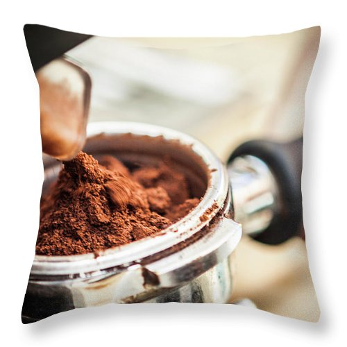 Mature Adult Throw Pillow featuring the photograph Close Up Of Espresso Grounds In Machine by Manuel Sulzer