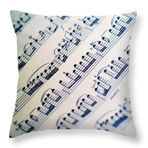 Sheet Music Throw Pillow featuring the photograph Close-up Of Sheet Music by Medioimages/photodisc