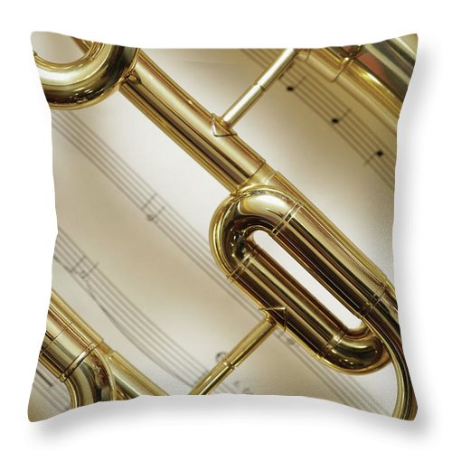 Sheet Music Throw Pillow featuring the photograph Close-up Of Trumpet by Medioimages/photodisc