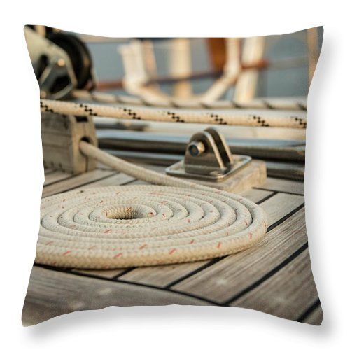 Sailboat Throw Pillow featuring the photograph Coiled Line, Rope, On Teak Deck Of 62 by Gary S Chapman