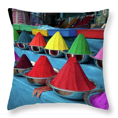 In A Row Throw Pillow featuring the photograph Colorful Dyes At Indian Market by Photo By Meredith Narrowe