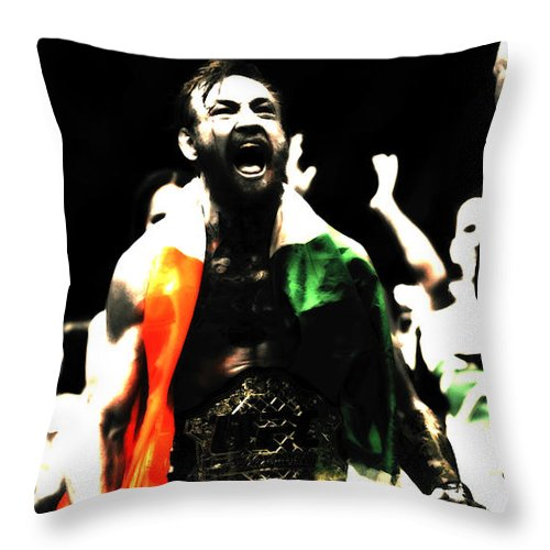 Conor Mcgregor Throw Pillow featuring the mixed media Conor Mcgregor Getting It Done by Brian Reaves
