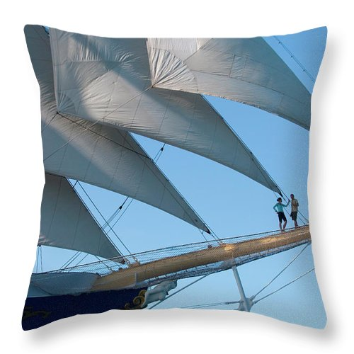 Heterosexual Couple Throw Pillow featuring the photograph Couple On Bowsprit Of Sailing Ship by Holger Leue