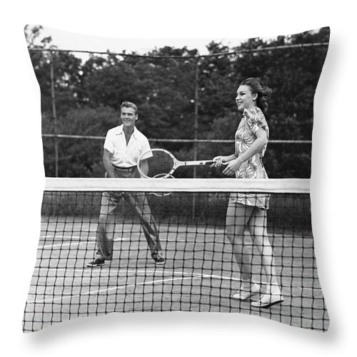 Heterosexual Couple Throw Pillow featuring the photograph Couple Playing Tennis by George Marks