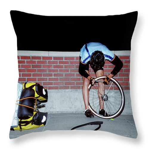 Problems Throw Pillow featuring the photograph Cyclist Fixing Flat Tire by Brad Wenner