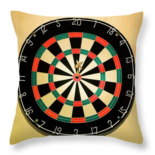 Expertise Throw Pillow featuring the photograph Dart In Bulls Eye On Dart Board by Fuse