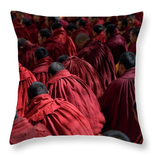 Punishment Throw Pillow featuring the photograph Debating Monks by Caval