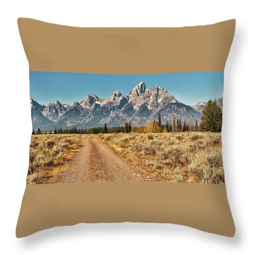 Tranquility Throw Pillow featuring the photograph Dirt Road To Tetons by Jeff R Clow