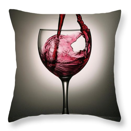 Alcohol Throw Pillow featuring the photograph Dramatic Red Wine Splash Into Wine Glass by Donald gruener