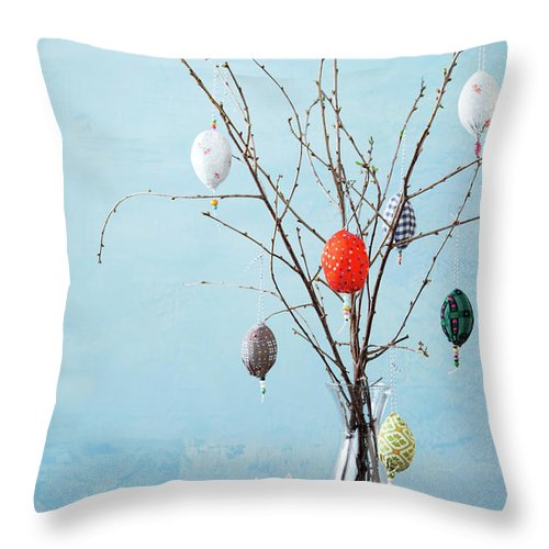 Holiday Throw Pillow featuring the photograph Egg-shaped Decorations On Branches by Stefanie Grewel