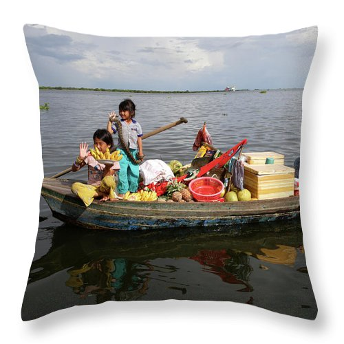 Child Throw Pillow featuring the photograph Family & Snake Sell Wares On Tonle by Rosemary Calvert