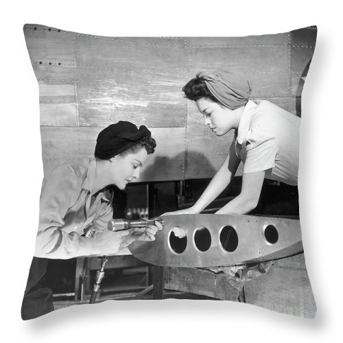 Working Throw Pillow featuring the photograph Female Workers Working On Plane by George Marks
