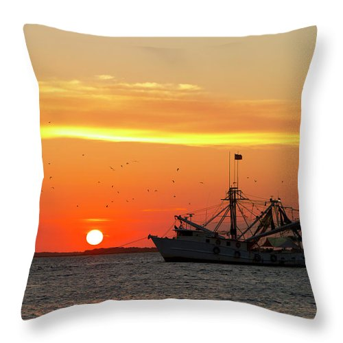 Water's Edge Throw Pillow featuring the photograph Fishing Boat At Sunset by Tshortell