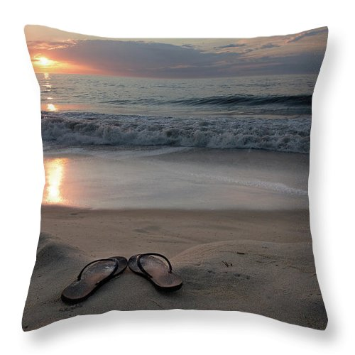 Water's Edge Throw Pillow featuring the photograph Flip-flops On The Beach by Sdominick