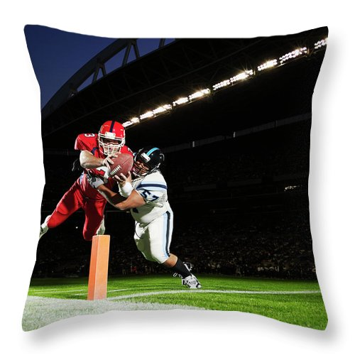 Sports Helmet Throw Pillow featuring the photograph Football Player Diving Into End Zone by Thomas Barwick