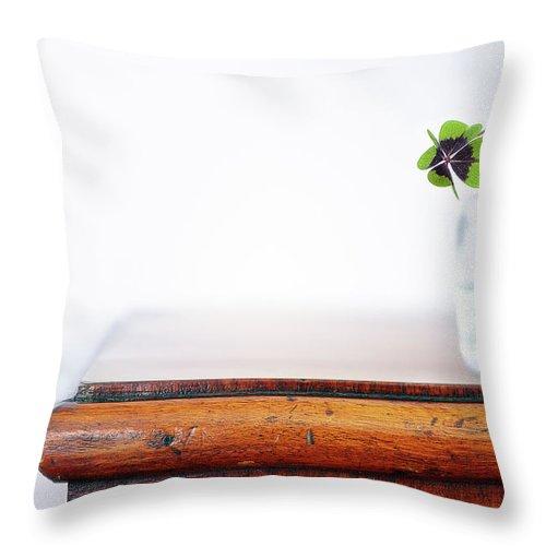 Vase Throw Pillow featuring the photograph Fourleaf Cloverin Vase On Dresser by Elisabeth Schmitt