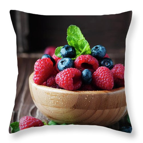 Vitamin Throw Pillow featuring the photograph Fresh Sweet Raspberry And Bluberry by Oxana Denezhkina