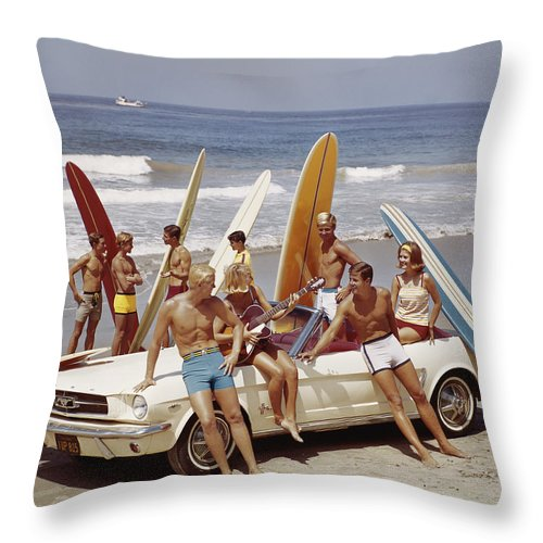 Young Men Throw Pillow featuring the photograph Friends Having Fun On Beach by Tom Kelley Archive