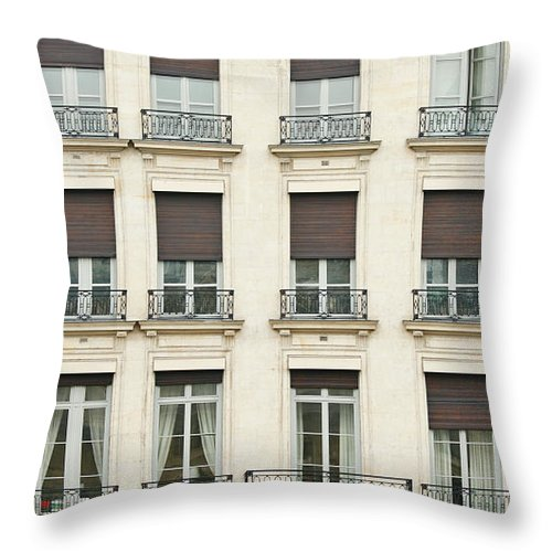 Apartment Throw Pillow featuring the photograph Front View Of Paris Architecture by S. Greg Panosian