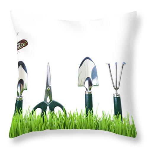 Grass Throw Pillow featuring the photograph Garden Tools by Liliboas
