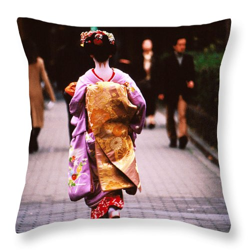Headwear Throw Pillow featuring the photograph Geisha In Kimono Walking Away, Pontocho by Lonely Planet