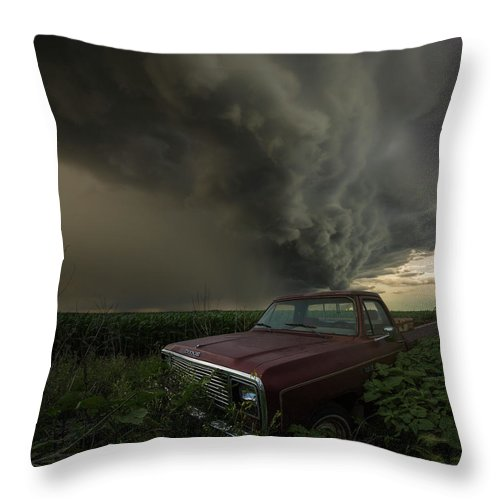 Severe Throw Pillow featuring the photograph Get Outta Dodge by Aaron J Groen