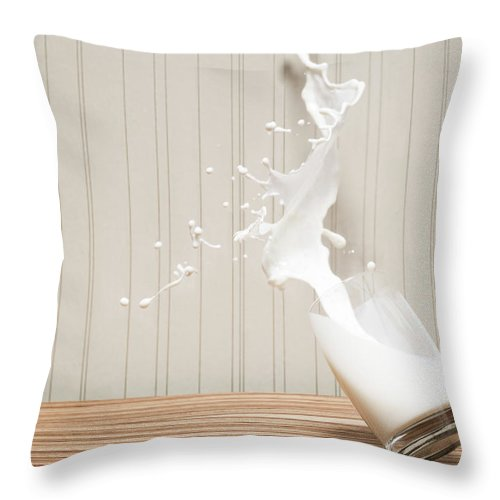 Milk Throw Pillow featuring the photograph Glas Of Milk Spilling by Henrik Sorensen