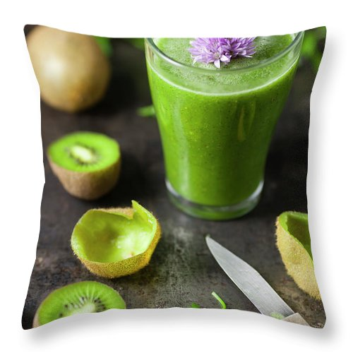 Cutting Board Throw Pillow featuring the photograph Glass Of Smoothie With Kiwi, Parsley by Westend61