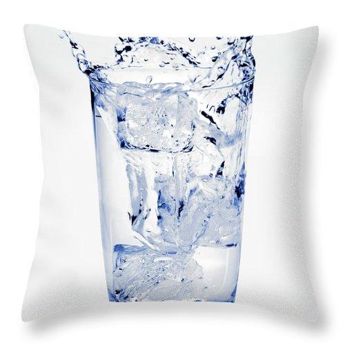 White Background Throw Pillow featuring the photograph Glass Of Water Splashing Around by Maria Toutoudaki