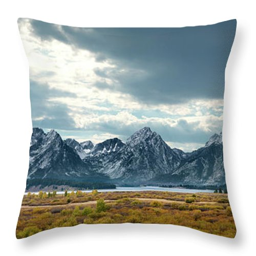 Scenics Throw Pillow featuring the photograph Grand Tetons In Dramatic Light by Ed Freeman
