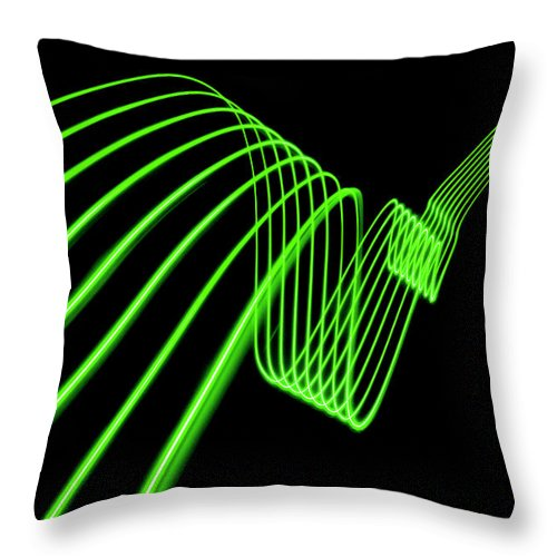 Laser Throw Pillow featuring the photograph Green Abstract Coloured Lights Trails by John Rensten