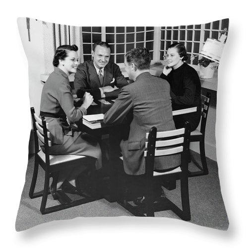 Heterosexual Couple Throw Pillow featuring the photograph Group At A Table by George Marks
