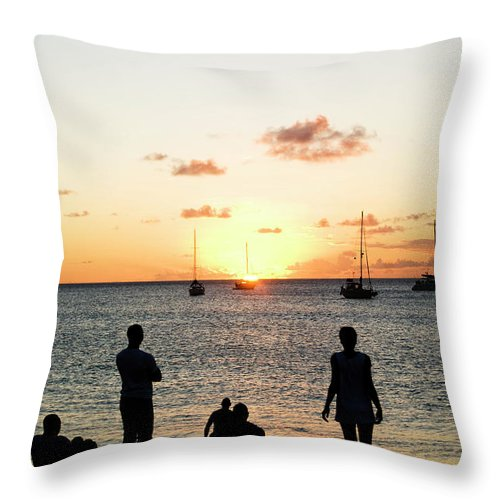 Recreational Pursuit Throw Pillow featuring the photograph Group Of Young Friends On Beach At by Jaminwell