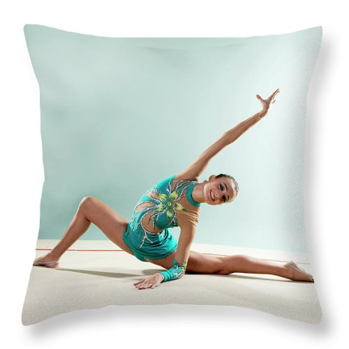 Human Arm Throw Pillow featuring the photograph Gymnast, Smiling, Bending Backwards by Emma Innocenti